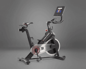 A black, grey, and red exercise bike with display console.